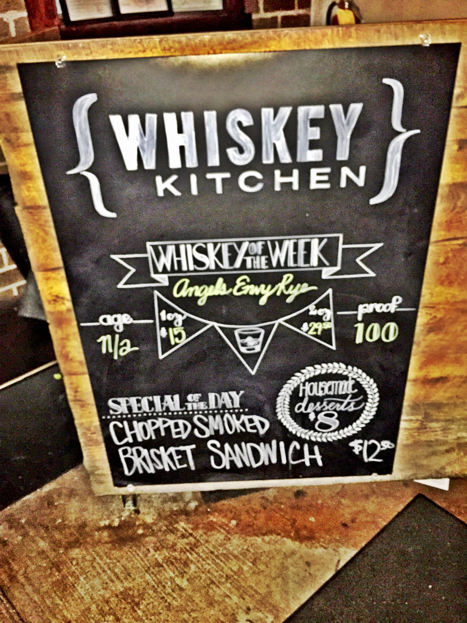 Entry sign at Whiskey Kitchen